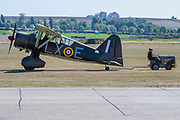 A Westland Lysander is towed on the flight line - Duxford Battle of Britain Air Show at the Imperial War Museum. Also commemorating the 50th anniversary of the 1969 Battle of Britain film. It runs on Saturday 21 & Sunday 22 September 2019