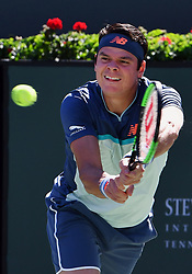 March 16, 2019 - Indian Wells, CA, U.S. - INDIAN WELLS, CA - MARCH 15: Milos Raonic (CAN) returns the ball in the first set of a semifinals match played during the BNP Paribas Open at the Indian Wells Tennis Garden in Indian Wells, CA.  (Photo by John Cordes/Icon Sportswire) (Credit Image: © John Cordes/Icon SMI via ZUMA Press)
