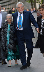 Rolf Harris arrives at Southwark Crown Court, London, UK, surrounded by friends and family (pictured left is Rolf's wife Alwen).<br /> <br /> Tuesday, 6th May 2014. Picture by Ben Stevens / i-Images
