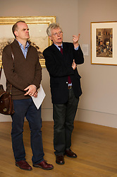 Kenneth McKonkey, Emeritus Professor of Art History and Dean of the Facuty of Art and Design, the University of Northumberland (glasses) was on hand to offer hsi views on the exhibition.<br /> <br /> Arthur Melville: Adventures in Colour exhibition goes on display at the Scottish National Gallery. Melville (1855-1904) was one of the finest British watercolour painters of the Victorian - and indeed any - era. The audacity and drama of his compositions, his original, highly persoanl technique, and above all, his ability to evoke colour and light with the brilliance of stained-glass, mark him as a painter of outstanding talent.<br /> © Ger Harley/ StockPix.eu 8 October 2015