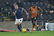 Bolton Wanderers defender Prince-Desire Gouano and Hull City midfielder Moses Odubajo go for the ball  during the Sky Bet Championship match between Hull City and Bolton Wanderers at the KC Stadium, Kingston upon Hull, England on 12 December 2015. Photo by Ian Lyall.