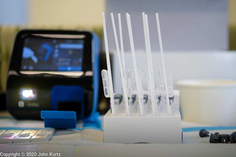 """15 NOVEMBER 2020 - WEST DES MOINES, IOWA: COVID-19 swabs ready to be tested at the Doctors NOW clinic in West Des Moines. Hundreds of people lined up for drive up COVID-19 tests at the Doctors NOW clinic in West Des Moines. Iowa is seeing a surge in COVID-19 (Coronavirus) cases and the state's """"Test Iowa"""" public testing program is swamped with some people waiting 3 - 5 days for an appointment for a drive up test. As of Sunday, 15 November, Iowa had the 3rd highest Coronavirus (SARS-CoV-2) infection rate in the country with 4,432 new cases reported in the previous 24 hours and 1,279 people hospitalized for COVID-19. Des Moines area hospitals have warned that they are at capacity and many hospitals are reporting staffing shortages because workers have come down with COVID-19.     PHOTO BY JACK KURTZ"""