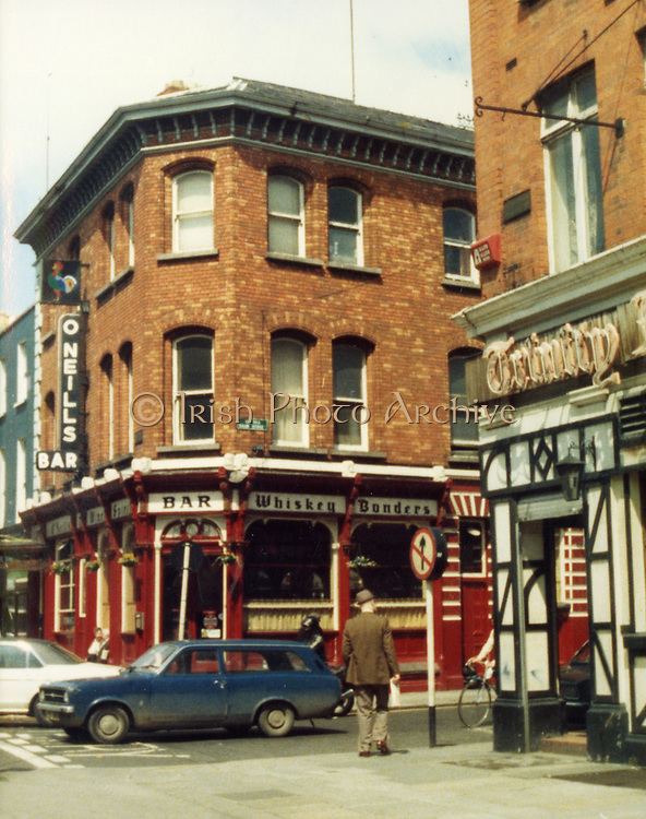 Old Dublin Amature Photos Date Unknown With 1980s O'Neills Pub, Trinity, Ford Escort Estate, Car, Old amateur photos of Dublin streets churches, cars, lanes, roads, shops schools, hospitals
