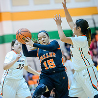 Gallup Bengal Katianna Toledo (15) catches a pass under pressure from the Wingate Bears during the Wingate Holiday Classic girls basketball tournament at Wingate High School Friday.