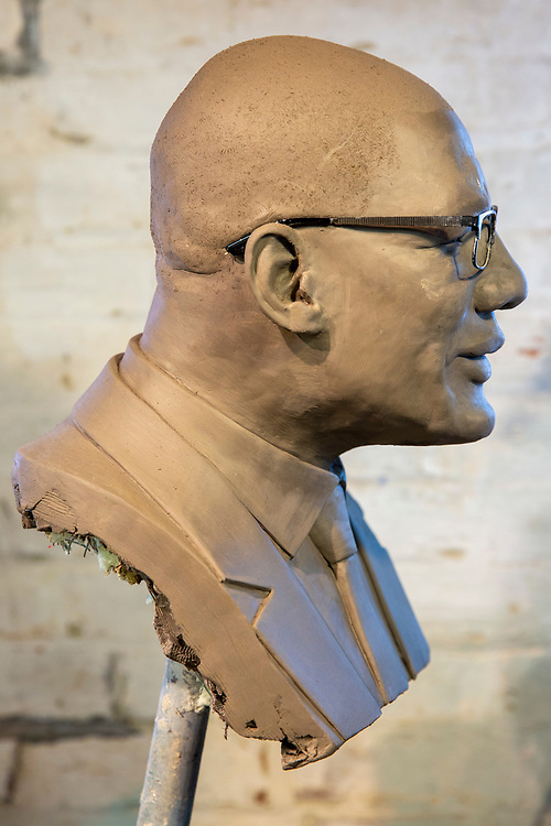 Sculptor Adam Hynes working on the bust of his Uncle Sir Rodney Williams,  Governor-General of Antigua and Barbuda in his studio on the 10th of July 2020 in Folkestone, Kent. (photo by Andy Aitchison)