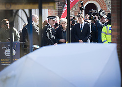 © Licensed to London News Pictures. 15/03/2018. Salisbury, UK. British Prime Minister THERESA MAY (C) meets with Chief Constable Kier Pritchard as she visits The Maltings shopping area in Salisbury, Wiltshire where Former Russian spy Sergei Skripal and his daughter Yulia were found after being poisoned with nerve agent. The couple where found unconscious on bench in Salisbury shopping centre. A policeman who went to their aid is currently recovering in hospital. Photo credit: Peter Macdiarmid/LNP