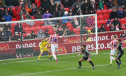 Stoke City's Sam Vokes (centre) see his header go on to hit the cross bar during the Sky Bet Championship at the bet365 Stadium