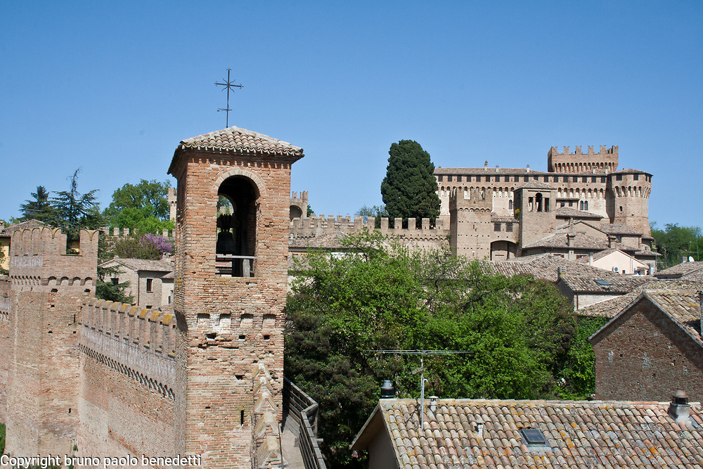 view of Gradara village in Italy with castle,roofs anc walls with merlons
