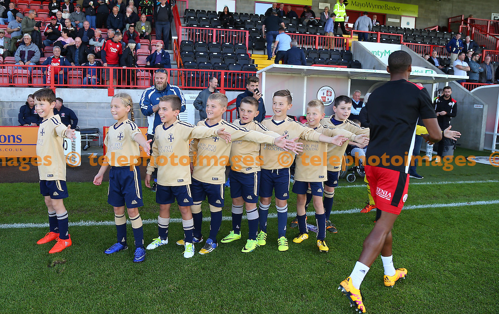 Player  escorts during the Sky Bet League 2 match between Crawley Town and Blackpool at the Checkatrade Stadium in Crawley. October 1, 2016.<br /> James Boardman / Telephoto Images<br /> +44 7967 642437