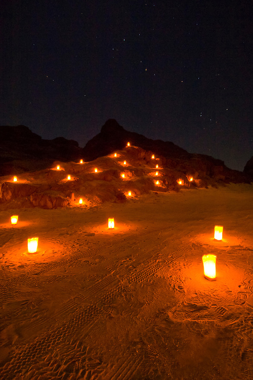 A candlelit mountainside in a canyon is the setting of a special dinner put on by Abenteuer Afrika Safari tours, outside Swakopmund in the Namib Desert, Namibia