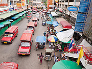 24 JUNE 2011 - CHIANG MAI, THAILAND: Pickup trucks converted to taxis line up for customers at the market in Chiang Mai, Thailand.  PHOTO BY JACK KURTZ