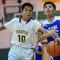 Zuni Thunderbird Marlon Lowsayate (15) loses the ball to a block from Tohatchi Cougar Justin Leonard (10) Thursday at Wingate High School.