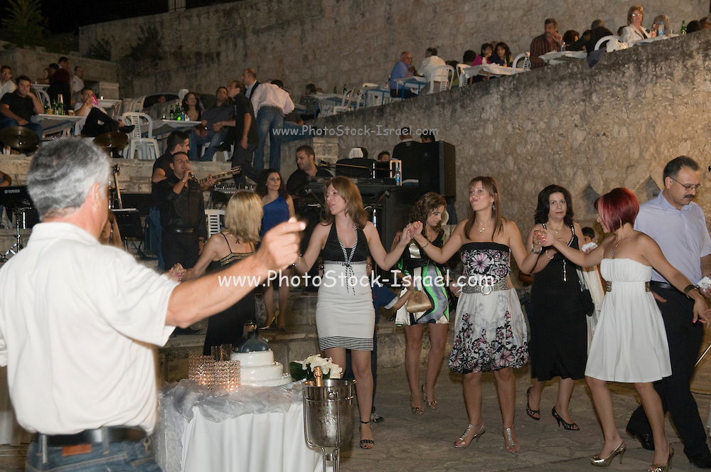 Cyprus, Lysos, A typical Cypriot Greek wedding in the town square all are invited. Three thousand people from the village and near by villages were expected. The guests dancing .