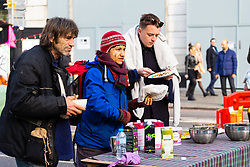 Breakfast is served on Oxford Street as hundreds of environmental protesters from Extinction Rebellion occupy Marble Arch, camping in the square and even on the streets, blocking access to traffic on Park Lane and Oxford Street in London's usually traffic-heavy west end. . London, April 16 2019.
