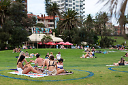 Friends are seen sunbaking in their COVIDSafe circles at St Kilda Beach during COVID-19 in Melbourne, Australia. Premier Daniel Andrews comes down hard on Victorians breaching COVID 19 restrictions, threatening to close beaches if locals continue to flout the rules. This comes as Victoria sees single digit new cases. (Photo by Dave Hewison/Speed Media)