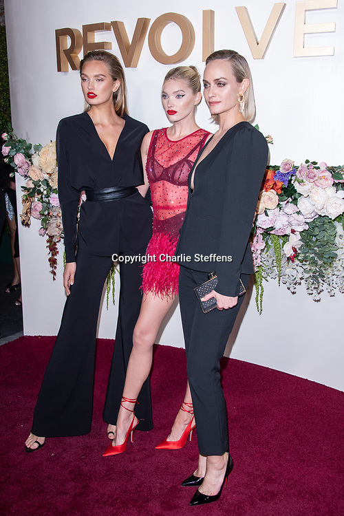L to R: ROMEE STRIJD, ELSA HOSK, and AMBER VALLETTA attend the 3rd Annual #REVOLVEawards at Goya Studios in Los Angeles, California