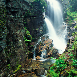 Avalanche Falls at the head of the Flume gorge in Franconia Notch State Park.  New Hampshire's White Mountains.