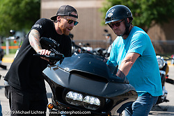 Harley-Davidson employee Patrick Flynn of Costa Mesa, CA helped Matt Wiegand of Stillwater, MN with a Roadglide Special at the Harley-Davidson test rides out of the Sturgis Civic Center on Lazelle during Sturgis Black Hills Motorcycle Rally. SD, USA. Thursday, August 8, 2019. Photography ©2019 Michael Lichter.