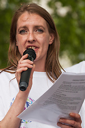 London, UK. 30 May, 2019. Poppy Rose, co-founder of SEND National Crisis and SEND parent, addresses fellow campaigners attending a demonstration in Parliament Square to demand improvements in the diagnosis and assessment of young people with SEND, assistance for their families, funding and legal and financial accountability for local authorities in their treatment of young people with SEND and their families.