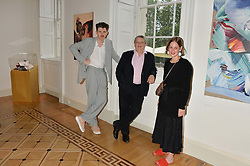 """Left to right. artist MATTHEW STONE, SIR NORMAN ROSENTHAL and SHONAGH MARSHALL curator of the exhibition at a private view of work by Matthew Stone """"Healing The Wounds' held at Somerset House, The Strand, London on 4th July 2016."""