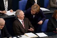 07 MAY 2010, BERLIN/GERMANY:<br /> Wolfgang Schaeuble (L), CDU, Bundesfinanzminister, und Angela Merkel (R), CDU, Bundeskanzlerin, im Gespraech, waehrend der Bundestagsdebatte zur Uebernahme von Gewaehrleistungen zum Erhalt der fuer die Finanzstabilitaet in der Waehrungsunion erforderlichen Zahlungsfaehigkeit der Hellenischen Republik, der sog. Griechenland-Hilfe, Plenum, Deutscher Bundestag<br /> IMAGE: 20100807-01-012<br /> KEYWORDS: Buergschaft, Bürgschaft, Finanzstabilitaetsgesetz, Gespräch, Wolfgang Schäuble