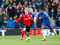 Football - 2013 / 2014 Premier League - Cardiff City vs. Hull City<br /> <br /> Mats Moller Daehli of Cardiff & Tom Huddlestone of Hull at Cardiff City Stadium.<br /> <br /> COLORSPORT/WINSTON BYNORTH