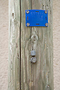 indication markings on a wooden electric post France