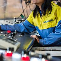 Tata Steel , Corby - woman steel worker on control panel in the steel works