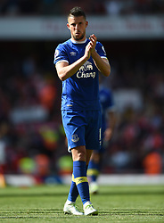 Everton's Kevin Mirallas applauds the away fans at full time