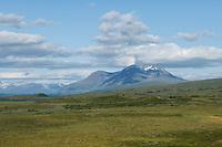 Distant mountain peak of Ahkka rises into sky along Padjelantaleden Trail, Padjelanta national park, Lapland, Sweden