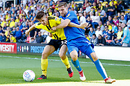 Wimbledon defender Ben Purrington (3), on loan from Rotherham United, in the tackle during the EFL Sky Bet League 1 match between Burton Albion and AFC Wimbledon at the Pirelli Stadium, Burton upon Trent, England on 1 September 2018.