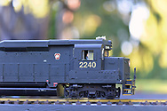 Old Westbury, New York, U.S. June 23, 2021. A train engineer is seen in the locomotive of a Pennsylvania Railroad G gauge model train during the Old Westbury Gardens opening reception for its outdoor Great Pine Railway exhibit, which runs until September 6.