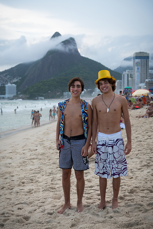 Rio de Janeiro, Brazil - March 5, 2019: Vinicius and Andre, both 18 and from São Paulo, visit Rio de Janeiro for Carnival. They are pictured here on Leblon Beach.