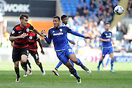 Cardiff City's Kenneth Johore (c) beats QPR's Grant Hill to the ball. Skybet football league championship match, Cardiff city v Queens Park Rangers at the Cardiff city stadium in Cardiff, South Wales on Saturday 16th April 2016.<br /> pic by Carl Robertson, Andrew Orchard sports photography.