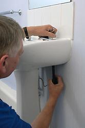 Housing Association plumber fixing tap UK