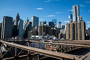 A landscape view from Brooklyn Bridge of the iconic sky scrapers in Lower Manhattan, also known as Downtown Manhattan, which is the financial district and centre for business, culture and government in the city of New York, United States of American.