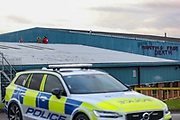 """Tamworth, United Kingdom, May 25, 2021: Police observe """"Profiting from Death"""", which is a graffiti the """"Palestine Action"""" activists group painted after they occupied an Israeli owned weapons manufacturer building in Tamworth, Amington Industrial Estate near Birmingham on Tuesday, May 25, 2021. """"Shut Elbit Down"""", """"Free! Free! Palestine"""" are among the slogans activists shouted whilst on the rooftop of the building. (Photo by Vudi Xhymshiti)"""
