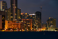 View of Apartment Buildings in Brickell Avenue with viow of Biscanyne Bay at Night in Miami.