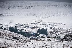 © London News Pictures. 28/02/2014, Mid Wales, UK<br /> Overnight snows cover the hilltops of the PUMLUMON (Plynlimon)  range of mountains above the A44 main trunk road at EISTEDDFA GURIG, on the border between Powys and Ceredigion. Photo credit: Keith Morris/LNP