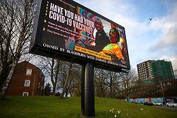 © Licensed to London News Pictures . 19/03/2021. Blackburn , UK . Government paid advert encouraging people to get a Covid-19 vaccine is seen on Barbara Castle Way . Exploring a year of experiences , lessons and consequences of Coronavirus in the NW of England . Photo credit : Joel Goodman/LNP