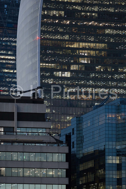 Evening generic office buildings in the City of London - the capitals financial district aka The Square Mile, on 2nd November 2018, in London, England.