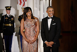 President Barack Obama and First Lady Michelle Obama wait for Prime Minister of Italy Matteo Renzi and Mrs. Agnese Landini to arrive at the North Portico of the White House on October 18, 2016 in Washington, DC. Photo by Olivier Douliery/Abaca
