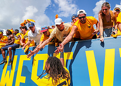 Sep 18, 2021; Morgantown, West Virginia, USA; West Virginia Mountaineers fans celebrate with players after defeating the Virginia Tech Hokies at Mountaineer Field at Milan Puskar Stadium. Mandatory Credit: Ben Queen-USA TODAY Sports