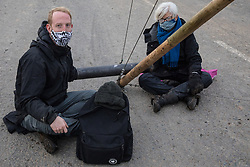 West Hyde, UK. 9th September, 2020. Anti-HS2 activists use a lock-on arm tube and tripod to block one of several entrances to the Chiltern Tunnel South Portal site for the HS2 high-speed rail link for the entire day. The protest action, at the site from which HS2 Ltd intends to drill a 10-mile tunnel through the Chilterns, was intended to remind Prime Minister Boris Johnson that he committed to remove deforestation from supply chains and to provide legal protection for 30% of UK land for biodiversity by 2030 at the first UN Summit on Biodiversity on 30th September.