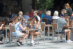 © Licensed to London News Pictures 15/06/2021. Sidcup, UK. People making the most of the hot sunny weather today with some outdoor dining in Sidcup High Street, South East London. The Met office has warned of thunderstorms later this week. Photo credit:Grant Falvey/LNP