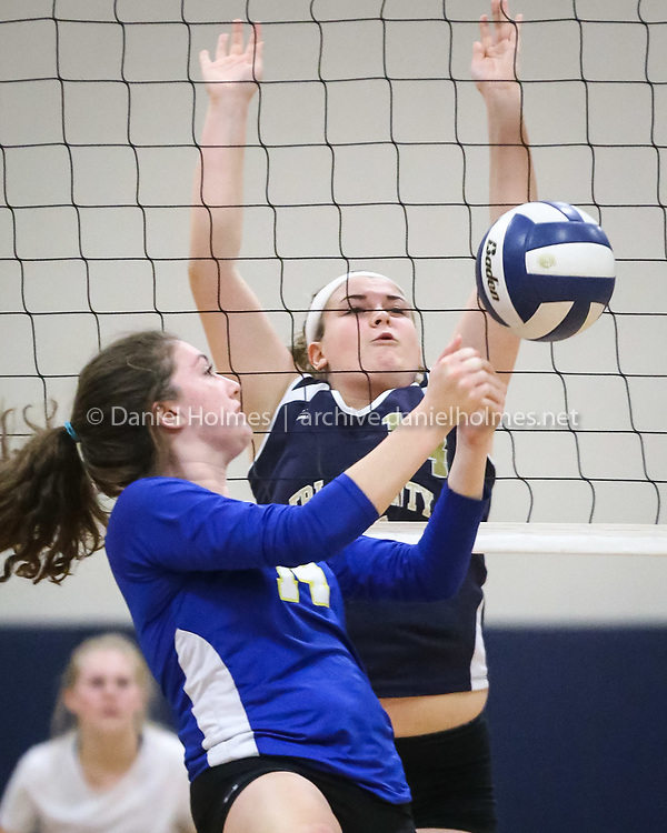 (11/1/16, FRANKLIN, MA) Tri-County's Tori Maynard goes up for the block as Norfolk County Agricultural School's Ava Burk hits the ball during the state vocational championship volleyball match at Tri-County Regional Vocational Technical High School in Franklin on Tuesday. Daily News and Wicked Local Photo/Dan Holmes