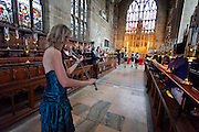 Violinist accompanies the Bride's walk up the aisle at St. Mary's Church, The Lace Market, Nottingham,