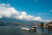 Boats on the banks of Lake Atitlan - a location seen as the most important single tourist attraction in Guatemala, and is Central Americas deepest lake. There are many villages on the banks of the lake, each with different identity and culture, the majority of the population in the region identify as indigenous Maya and many still wear traditional dress and speak Maya languages.