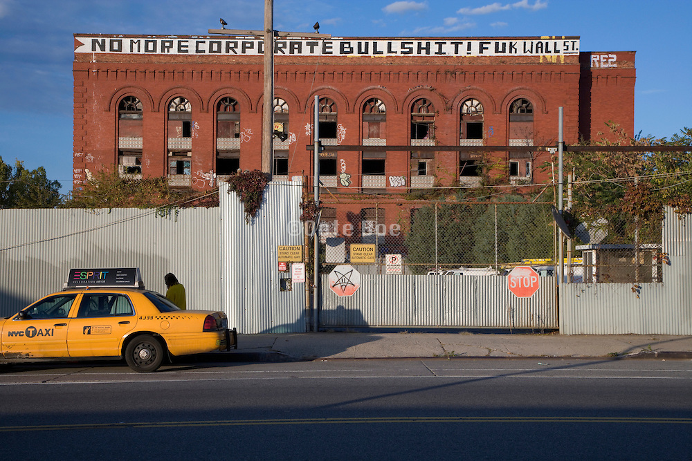 old factory building with economic downturn protest text