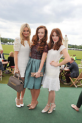 Left to right, LAURA WHITMORE, OLIVIA GRANT and ANGELA SCANLON at the St.Regis International Polo Cup between England and South America held at Cowdray Park, West Sussex on 18th May 2013.  South America won by 11 goals to 9 goals.